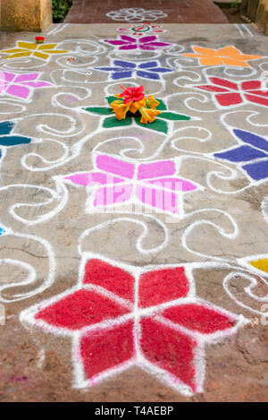 Vertical close up of a beautiful decorative pattern infront of a house in India. - Stock Photo