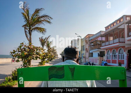 Horizontal streetview from the back of a cycle rickshaw in Pondicherry, India. - Stock Photo