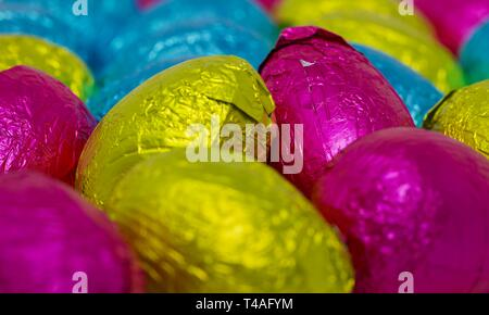 Colourful collection of foil wrapped Easter Eggs - Stock Photo