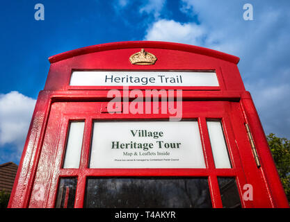 A telephone box in the village of Comberbach, Cheshire, Uk converted into a heritage tour for tourism. - Stock Photo
