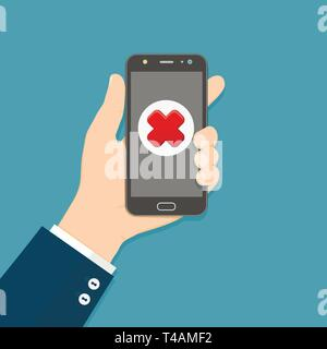 Cross mark on smartphone screen. Hand holds smartphone. Mobile phone with red cross mark. Failure concept. - Stock Photo