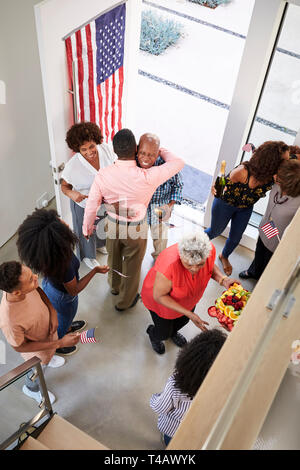 Black family arriving for an Independence Day house party with relatives,elevated view, vertical - Stock Photo