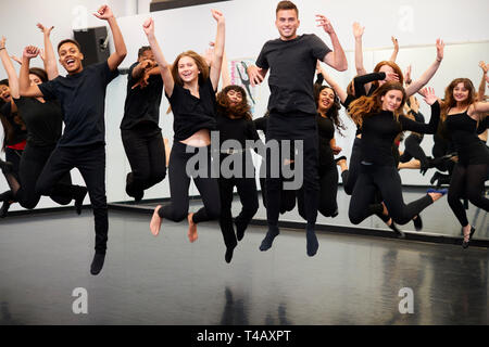 Male And Female Students At Performing Arts School Rehearsing Street Dance In Studio - Stock Photo