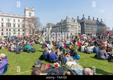 Westminster, London, UK; 15th April 2019; Crowds of Demonstrators in Parliament Square During Climate Protest Organised by Extinction Rebellion - Stock Photo