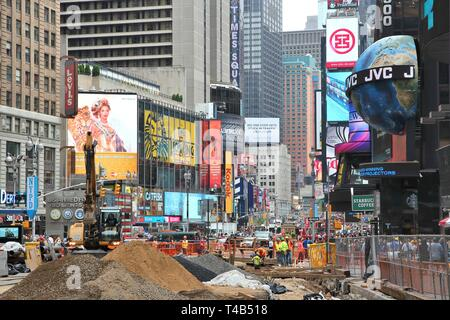 NEW YORK, USA - JULY 3, 2013: Workers perform construction works at Times Square in New York. The square at junction of Broadway and 7th Avenue has so - Stock Photo
