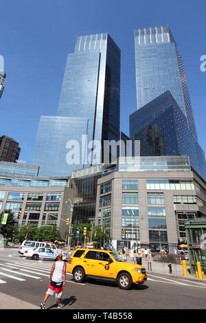 NEW YORK, USA - JULY 6, 2013: People cross the Columbus Circle in New York. Columbus Circle with famous Time Warner Center skyscrapers completed in 20 - Stock Photo