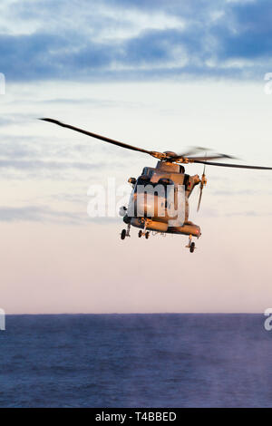 Merlin HM2 anti submarine helicopter of the Royal Navy operated by 814 Naval Air Squadron - Stock Photo