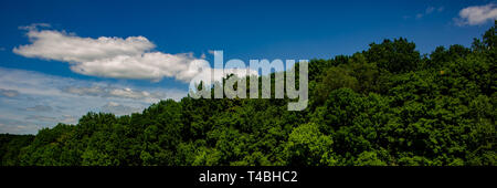 landscape with clouds in hilly terrain on a sunny day.Web banner. Summer season. - Stock Photo