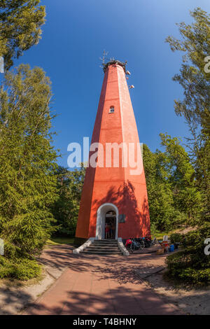 Red lighthouse on Hel peninsula in Poland - Stock Photo