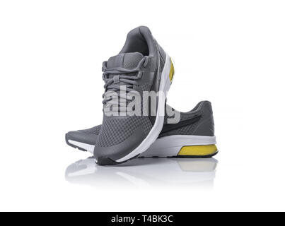 Unbranded black sport running shoes or sneakers isolated on white background. - Stock Photo