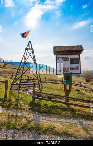 """KORNA, SLOVAKIA – APRIL 8 2019:  View of the oil seepage and its drainage trench in Korna village in protected natural area of Kysuce. Translation: """"S - Stock Photo"""