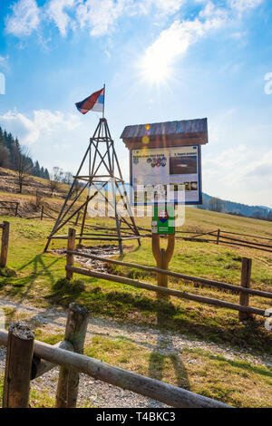 "KORNA, SLOVAKIA – APRIL 8 2019:  View of the oil seepage and its drainage trench in Korna village in protected natural area of Kysuce. Translation: ""S - Stock Photo"