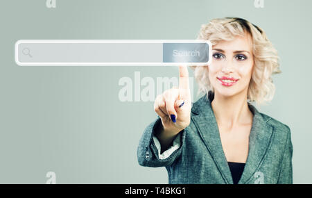Businesswoman pointing finger to empty address bar with search icon in virtual web browser - Stock Photo