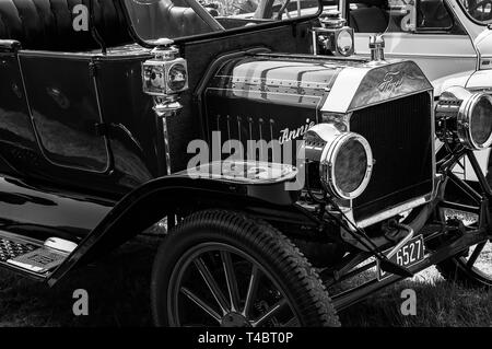 The front of a Ford Model T on display at a car show - Stock Photo