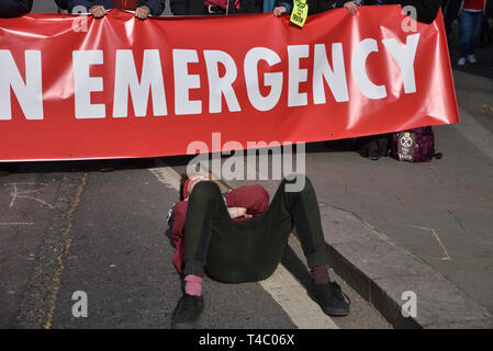 Parliament Square, London, UK. 15th Apr, 2019. Extinction Rebellion climate change protesters close Parliament Square. Credit: Matthew Chattle/Alamy Live News - Stock Photo