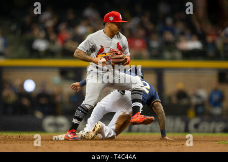 Milwaukee, WI, USA. 15th Apr, 2019. St. Louis Cardinals second baseman Kolten Wong #42 attempts to turn a double play the Major League Baseball game between the Milwaukee Brewers and the St. Louis Cardinals at Miller Park in Milwaukee, WI. John Fisher/CSM/Alamy Live News - Stock Photo