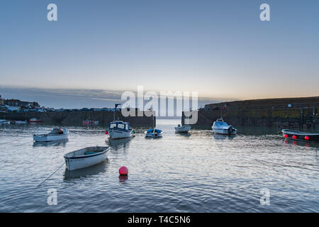 Mousehole, Cornwall, UK. 16th Apr, 2019. UK Weather. After 3 days of gale force winds and heavy rain, the weather has swung round this morning ahead of the Easter weekend. It was calm and mild at sunrise with the promise of a hot day ahead. Credit: Simon Maycock/Alamy Live News - Stock Photo