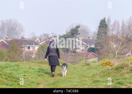 Northampton. U.K. 26th April 2019. Weather. A milder morning than of late with some sunshine coming through the low cloud, making it feel less cold for prople walking their dogs in Bradlaugh Feilds this morning. Credit: Keith J Smith./Alamy Live News - Stock Photo