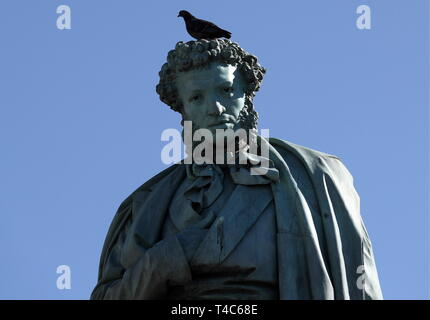 Moscow, Russia. 16th Apr, 2019. MOSCOW, RUSSIA - APRIL 16, 2019: A pigeon on the statue of Russian poet Alexander Pushkin in Pushkinskaya Square, central Moscow. Stanislav Krasilnikov/TASS Credit: ITAR-TASS News Agency/Alamy Live News - Stock Photo