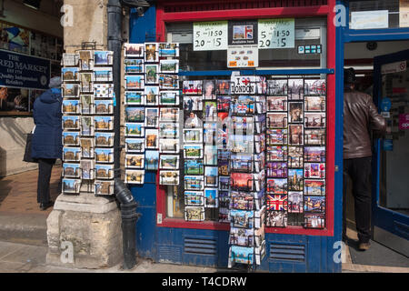 Racks of postcards on display outside a souvenir shop in Oxford, UK - Stock Photo