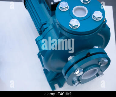 closeup water pump motor on white desk. drainage or irrigation hardware equipment - Stock Photo