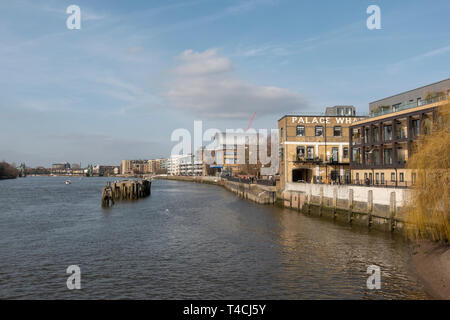General view along the Thames Path and the north bank of the River Thames looking west in Fulham, London, UK. - Stock Photo