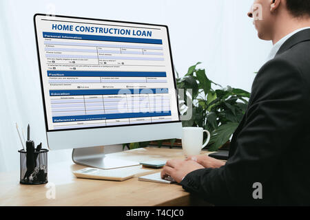 cropped view of man filling in - Stock Photo