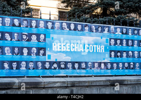 Signboard with names and pictures of protesters killed in the 2013/14 riots in Kiev during the protests at Maidan Nezalezhnosti (Maidan Square). Follo - Stock Photo