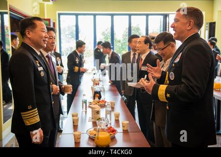 BUSAN, Republic of Korea (March 19, 2019) Rear Adm. Michael E. Boyle, commander, U.S. Naval Forces Korea, speaks with Republic of Korea (ROK) Chief of Naval Operations Adm. Shim, Seong Sup, during the 10-year anniversary celebration of the ROK Cheonghae Unit. Developed in 2009, Cheonghae was an anti-piracy unit established to protect civilian ships near the coast of Somalia under Combined Task Force 151. - Stock Photo