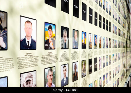 War in Donbass: names and pictures of soldiers killed in the pro-Russian uprest in the Donbass region are displayed on the outside walls of Saint Mich - Stock Photo