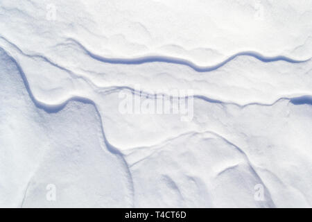 Snow textured background with thin mini crests/ridges going across like veins. Simple, minimalist, abstract Winter backdrop wallpaper with discrete sh - Stock Photo