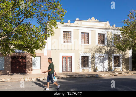 Coloured couple walking past historic  Colonial architecture in the town of McGregor, formerly Lady Grey, Robertson Wine Valley, Western Cape, South A - Stock Photo