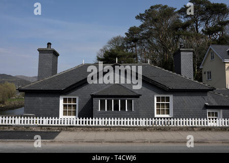 Welsh slate covered house and white picket fence in Porthmadog north wales uk - Stock Photo