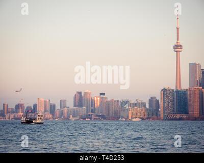 The CN Tower and spectacular skyline of Toronto, Ontario, Canada, as seen from Ward's Island (Toronto Islands) across Lake Ontario. - Stock Photo