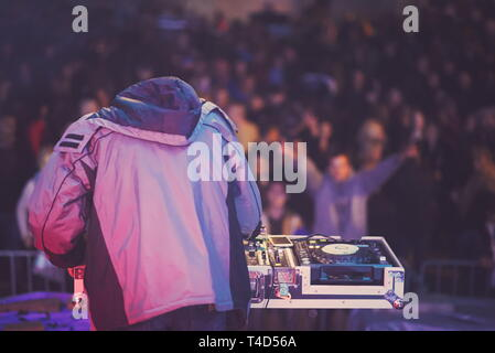 DJ on the Stage at Mixing Console Closeup - Stock Photo