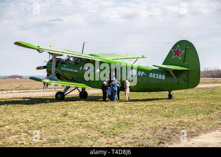 Samara, Russia - April 13, 2019: The Antonov An-2 a Soviet mass-produced single-engine biplane at an field aerodrome in summertime - Stock Photo