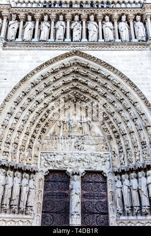 Close-up of The Portal of Judgement carved lintel and entrance to Notre Dame Cathedral, Paris, France Stock Photo