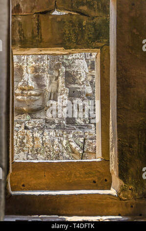 One of the passageways of the Bayon, a richly decorated Khmer and the only Angkorian state temple in Angkor Thom in Cambodia, with a famous smiling st - Stock Photo