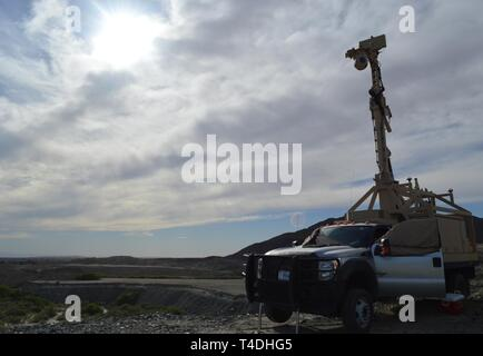 A Mobile Surveillance Camera on Garcia's Hill at the Andrade Point of Entry in Yuma, Arizona, March 28, 2019. The Department of Defense has deployed units across the Southwest Border at the request of U.S. Customs and Border Protection and is providing logistical, engineering, and force protection functions. - Stock Photo