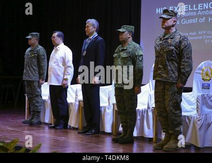 From left, Armed Forces of the Philippines Lt. Gen. Gilbert Gapay, commander, Southern Luzon Command, and Philippine Exercise Co-Director; Undersecretary Cardozo M. Luna, Undersecretary of the Department of National Defense; Sung Y. Kim, U.S. Ambassador to the Philippines; Armed Forces of the Philippines Gen. Benjamin Madrigal, Jr., AFP Chief of Staff; and U.S. Marine Brig. Gen. Christopher A. McPhillips, commanding general, 3rd Marine Expeditionary Brigade stand shoulder-to-shoulder at Tejeros Hall, Camp General Emilio Aguinaldo, Quezon City, Manila, Philippines, April 1, 2019. The ceremony r - Stock Photo