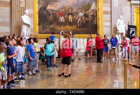Washington, DC USA. Jun 2013. A young male intern admiring the above artwork at the nation`s Capitol rotunda area. - Stock Photo