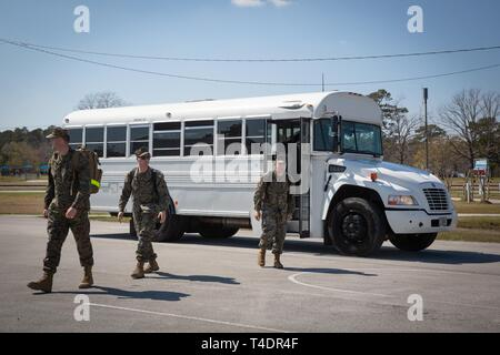 U.S. Marines exit a bus during a homecoming at Marine Corps Air Station Cherry Point, North Carolina, March 22, 2019. The Marines were deployed with Special Purpose Marine Air-Ground Task Force-Crisis Response-Africa. The Marines are assigned to 2nd Marine Aircraft Wing. - Stock Photo