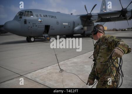 U.S. Air Force Master Sgt. Lance Stump, a loadmaster assigned to the 75th Expeditionary Airlift Squadron, Combined Joint Task Force-Horn of Africa (CJTF-HOA), prepares a C-130J Hercules at Camp Lemonnier, Djibouti, March 26, 2019, for the U.S. Department of Defense's relief effort in the Republic of Mozambique and surrounding areas following Cyclone Idai. Teams from CJTF-HOA, which is leading DoD support to relief efforts in Mozambique, began immediate preparation to respond following a call for assistance from the U.S. Agency for International Development's Disaster Assistance Response Team. - Stock Photo