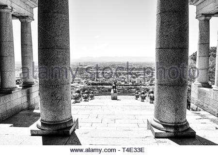 columned ruins over city - Stock Photo