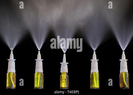 Spray of nasal sprays as a drug in case of cold - Stock Photo