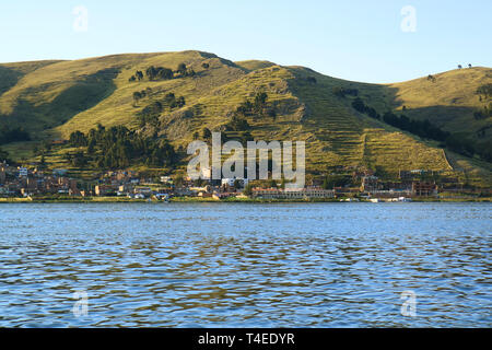 Puno Town on the Shore of Lake Titicaca View from Cruise Ship, Puno, Peru - Stock Photo