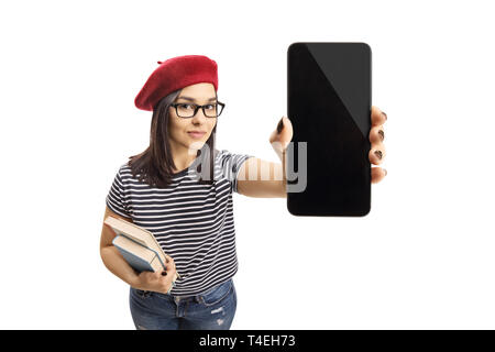 Young female holding books and a smartphone isolated on white background - Stock Photo