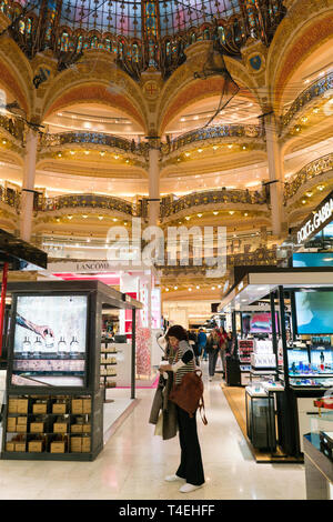 Paris, France - April 3, 2019: Galeries Lafayette interior in Paris. The architect Georges Chedanne designed the store where a Art Nouveau glass and - Stock Photo