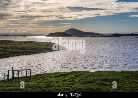 Road 848 along Lake Myvatn near Reykjahlid village in Iceland - Stock Photo