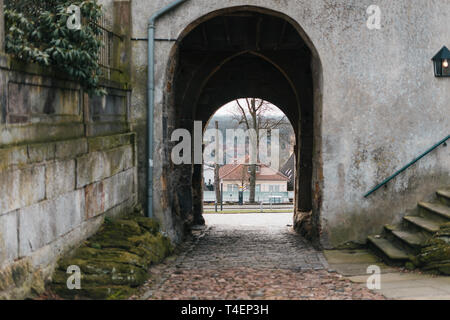 Medieval european castle arch with view on street - Stock Photo